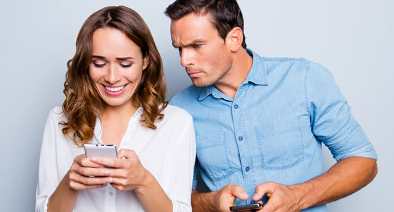 woman and man with smartphones