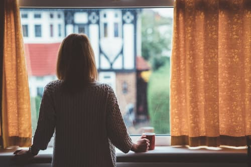woman staring out the window