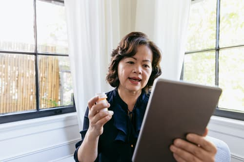 Senior woman talking with doctor online