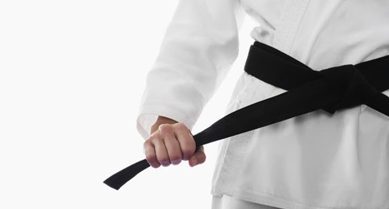 woman with black belt