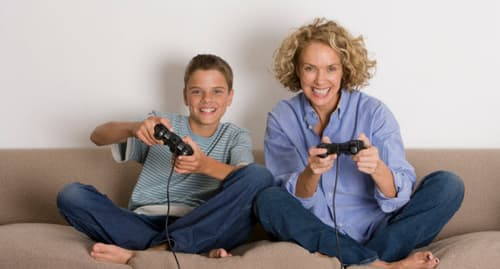 mother and son with video game controllers