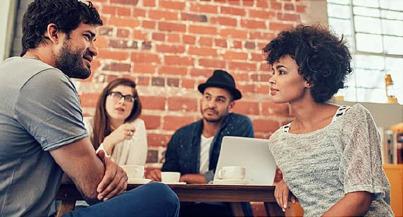 young people talking at coffee shop