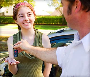 father giving teen keys to car