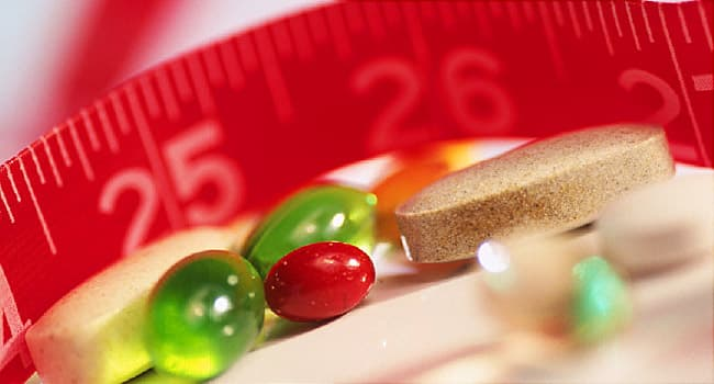 vitamins and measuring tape