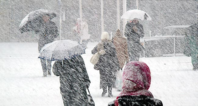 commuters in snow