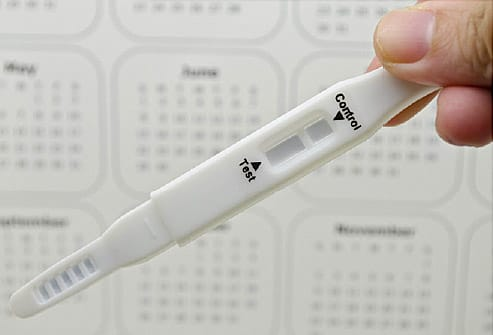 pregnancy test and calendar