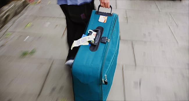 person pulling suitcase
