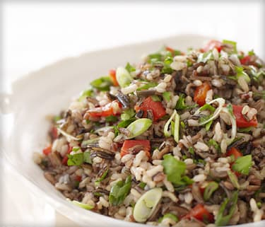 brown rice salad with roasted peppers and scallion