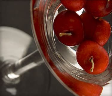 close-up of cherries in a martini glass