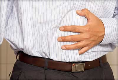 man holding stomach