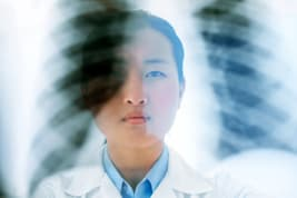 doctor holding up lung xray