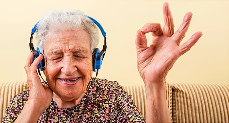 old woman listening to music