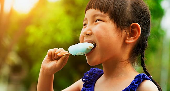 girl eating popsicle