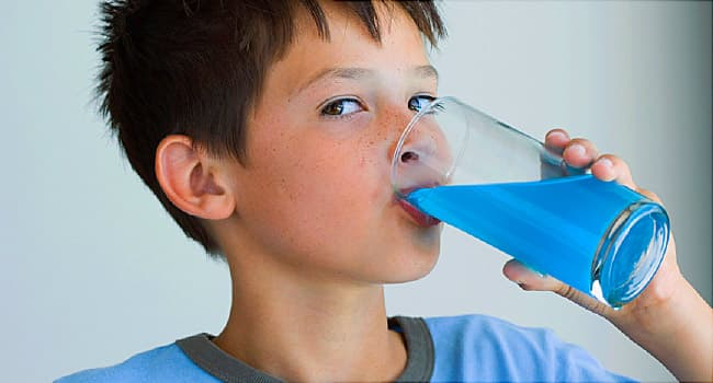 kid drinking blue drink