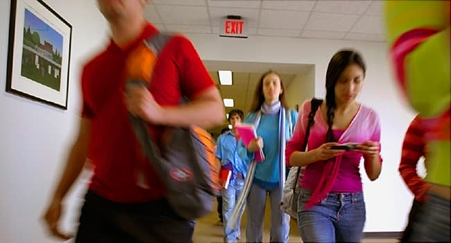 teens in school hallway