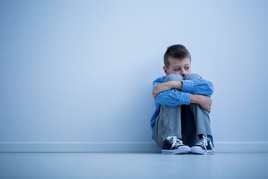 photo of boy with depression