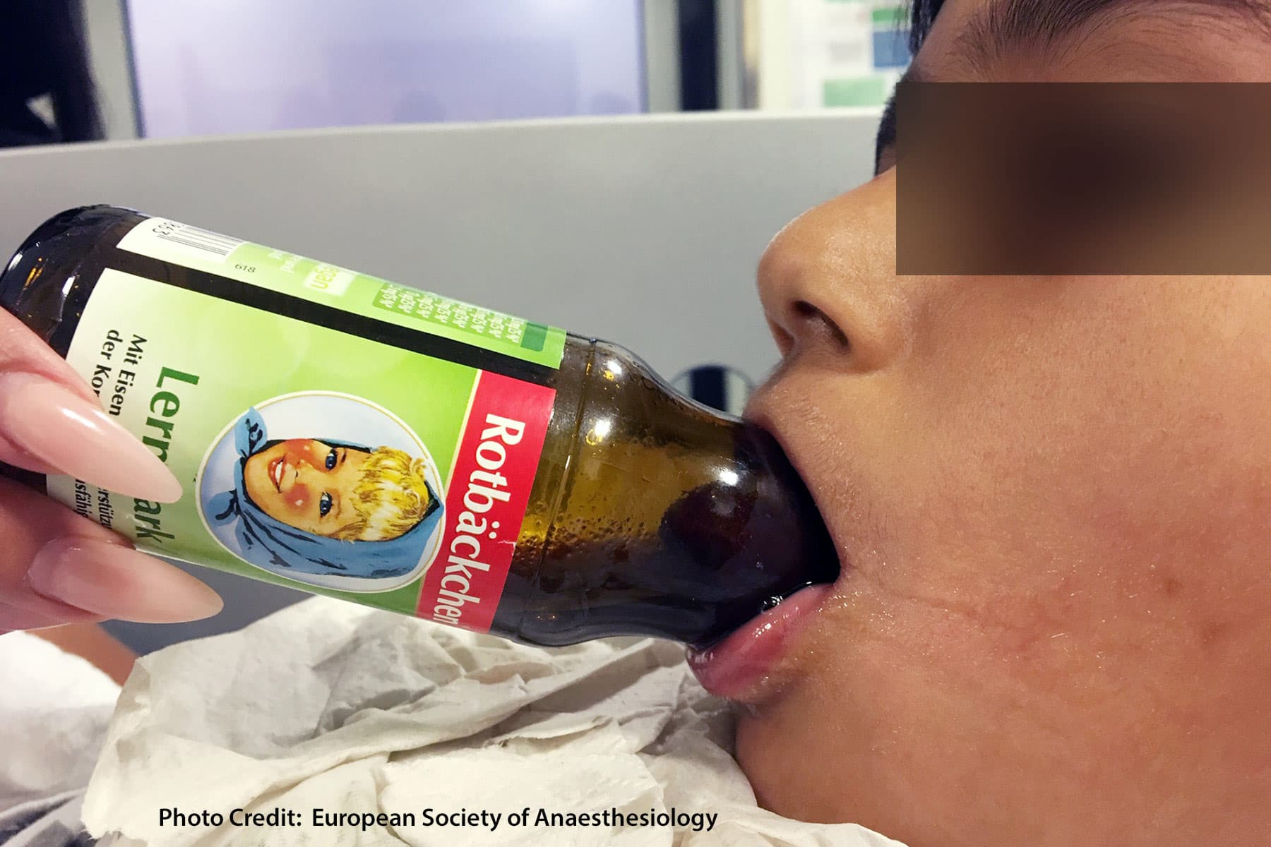 boy with tongue stuck in bottle