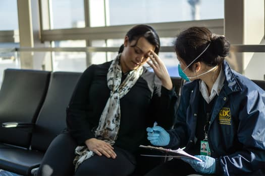photo of cdc working talking to woman