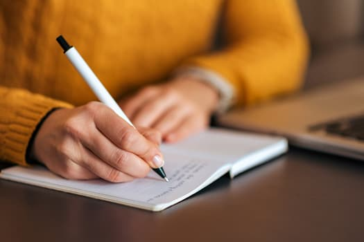 photo of person journaling