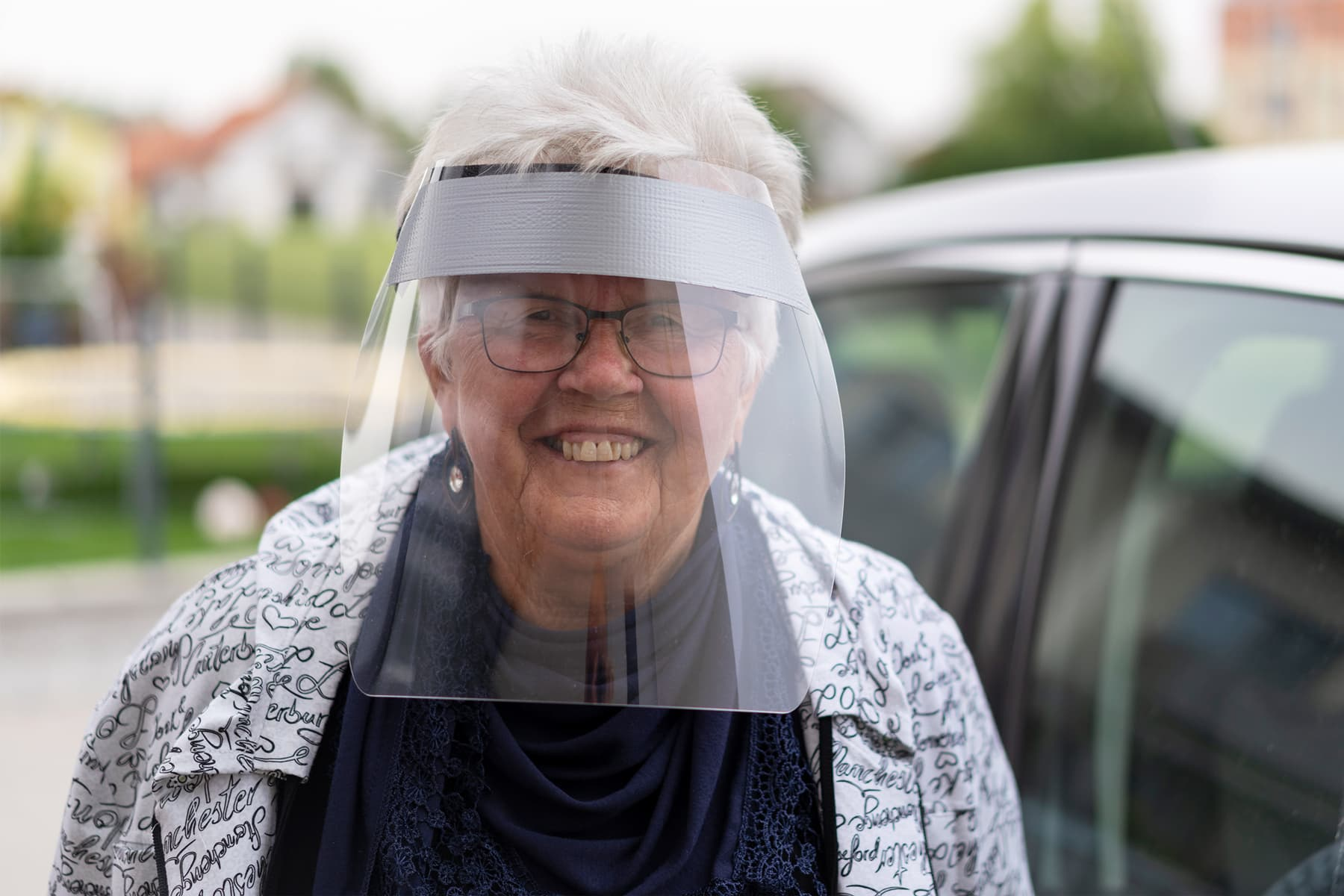 photo of woman wearing face shield