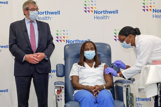 photo of woman getting vaccinated