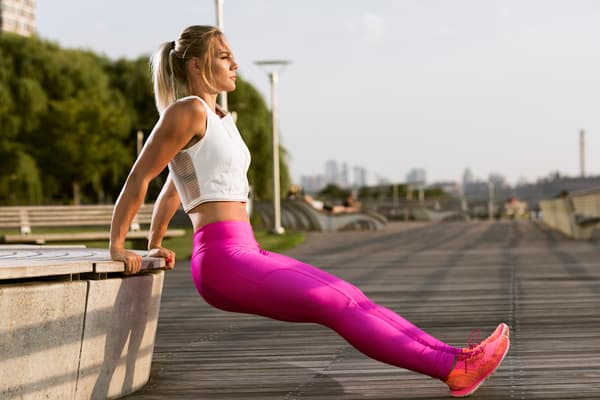 photo of fitness white woman tricep exercise