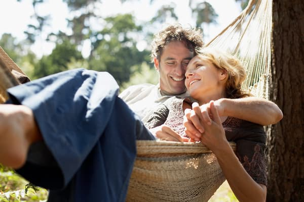 photo of mature couple relaxing in hammock