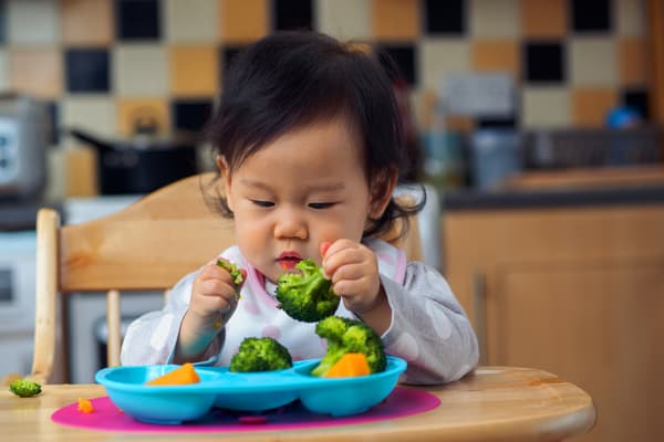 photo of baby eating veggies