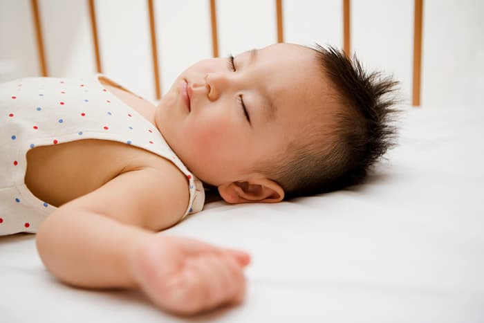 photo of baby sleeping in crib