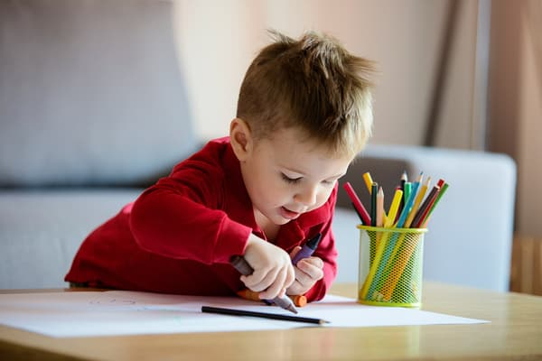photo of boy coloring