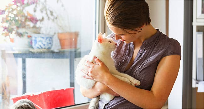 woman with pet cat