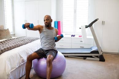 photo of man using weights