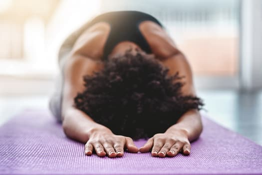 photo of fitness black woman yoga stretch