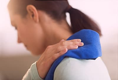 woman grasping shoulder
