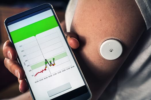photo of smartphone synced to glucometer