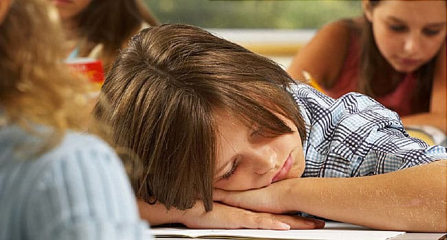 child asleep in classroom