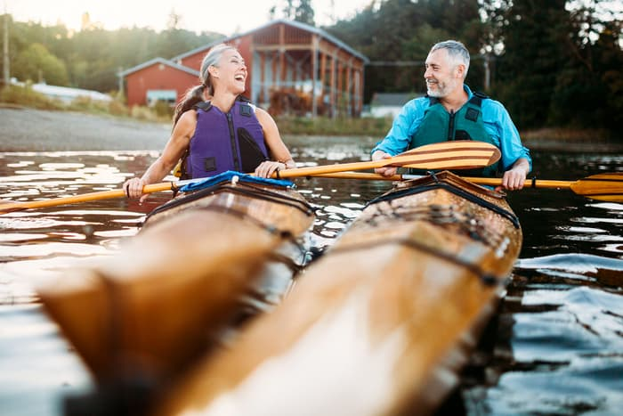 photo of mature couple in kayaks