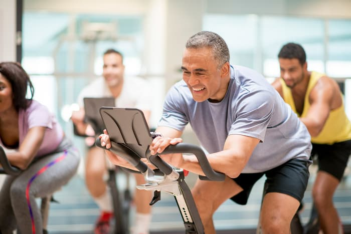 photo of mature man  in cycling class