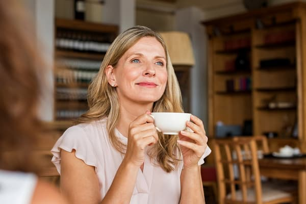 photo of mature woman holding cup
