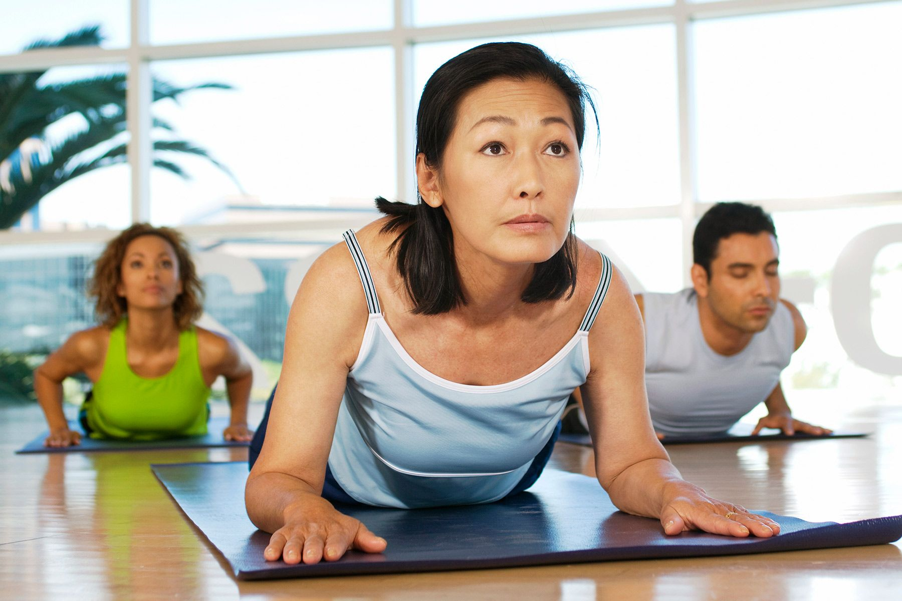 mature woman in yoga class