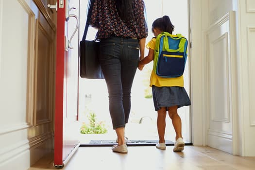 photo of mother and daughter walking out door