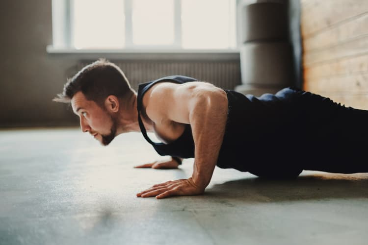 photo of man doing pushup