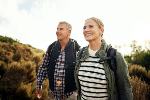 photo of mature couple hiking
