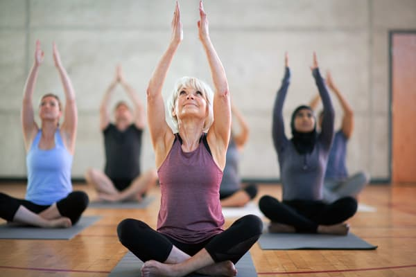 photo of raising arms in yoga class