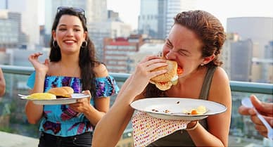 friends enjoying rooftop cookout