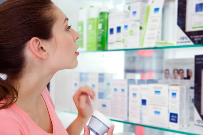photo of woman shopping for beauty products