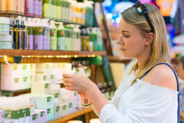photo of woman shopping for beauty product