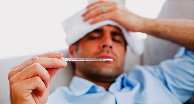 sick man with thermometer