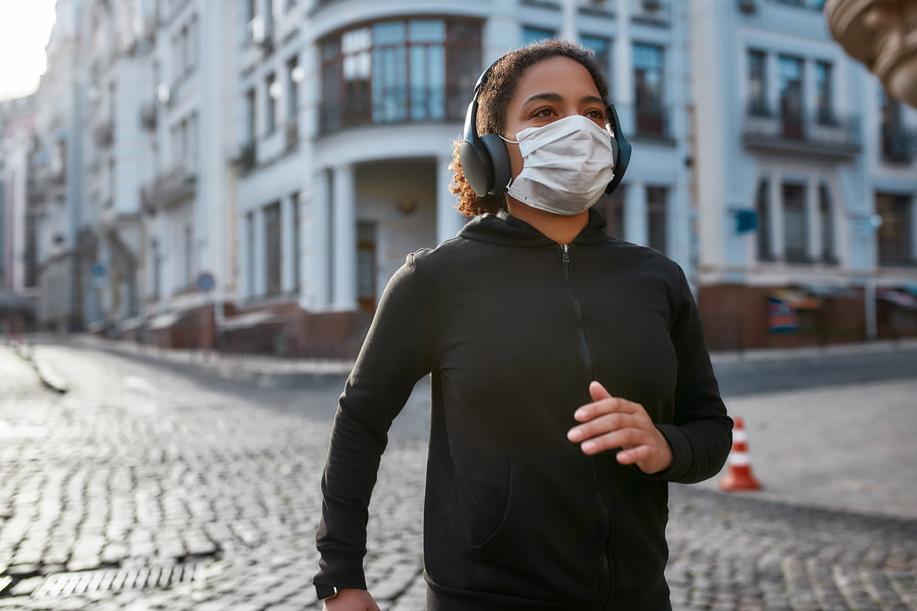 photo of woman exercising with mask on