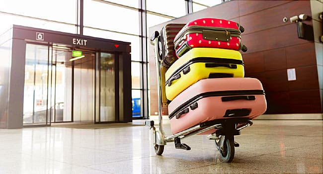 stacked luggage on cart